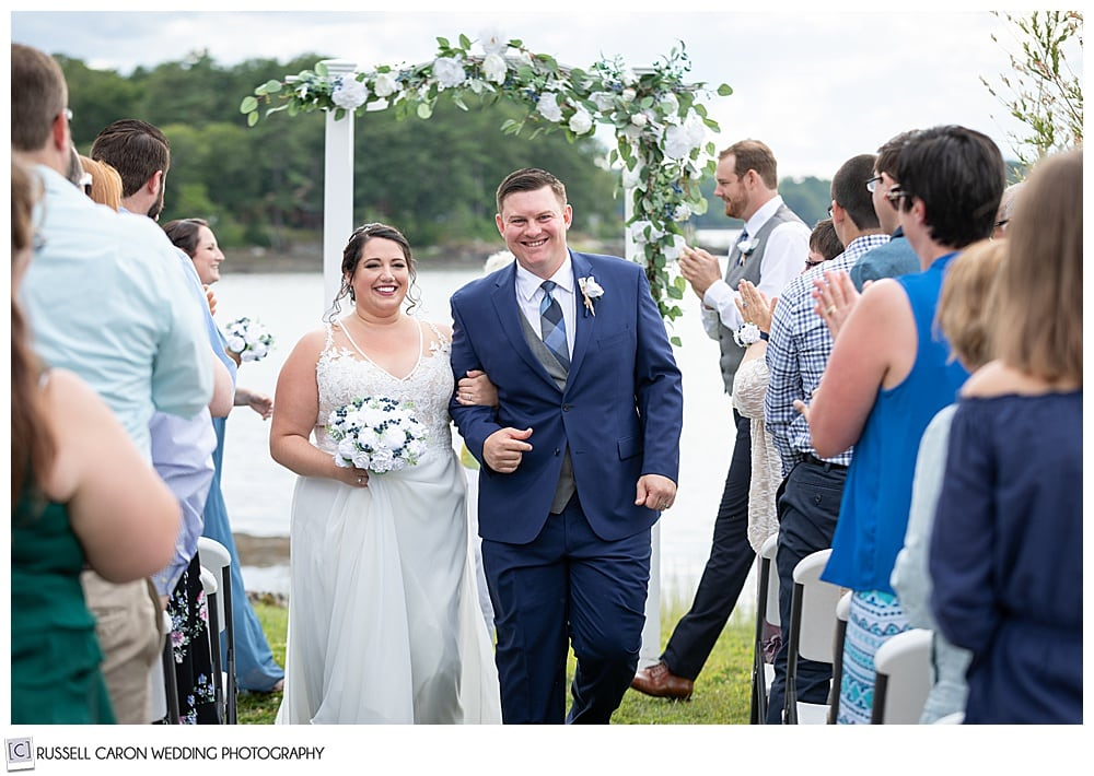 bride and groom during wedding recessional at their Edgecomb Maine wedding