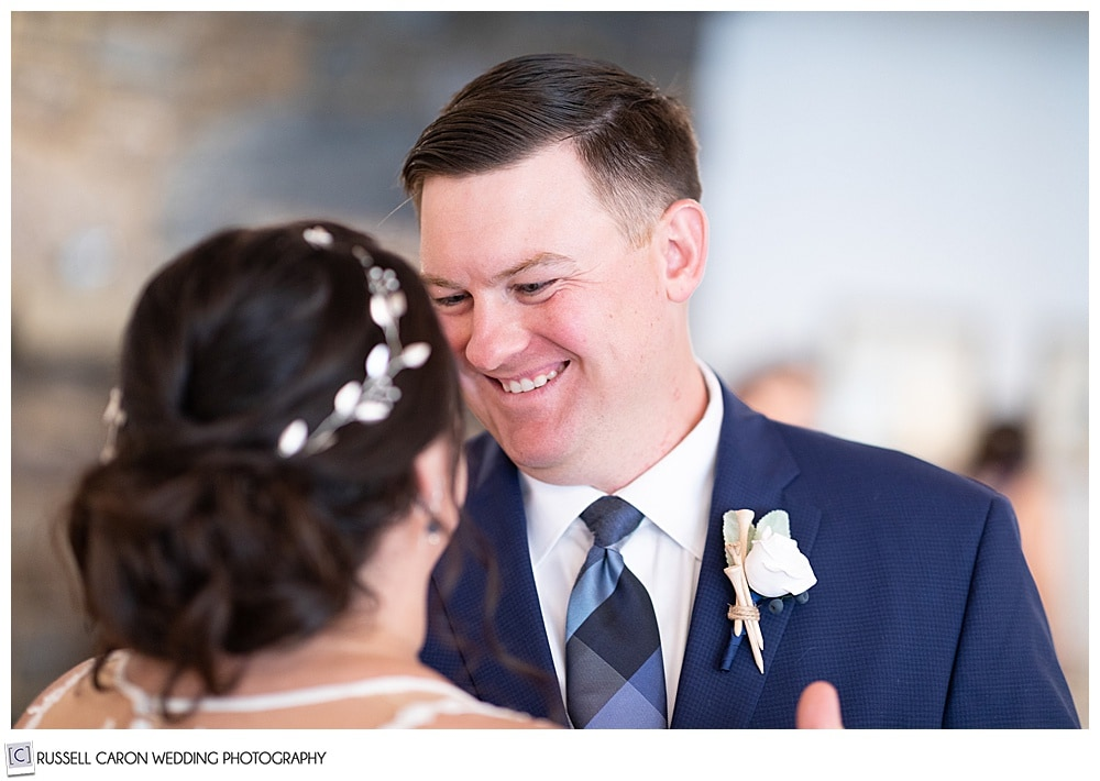 groom smiling at bride during their first dance at their Edgecomb Maine wedding reception