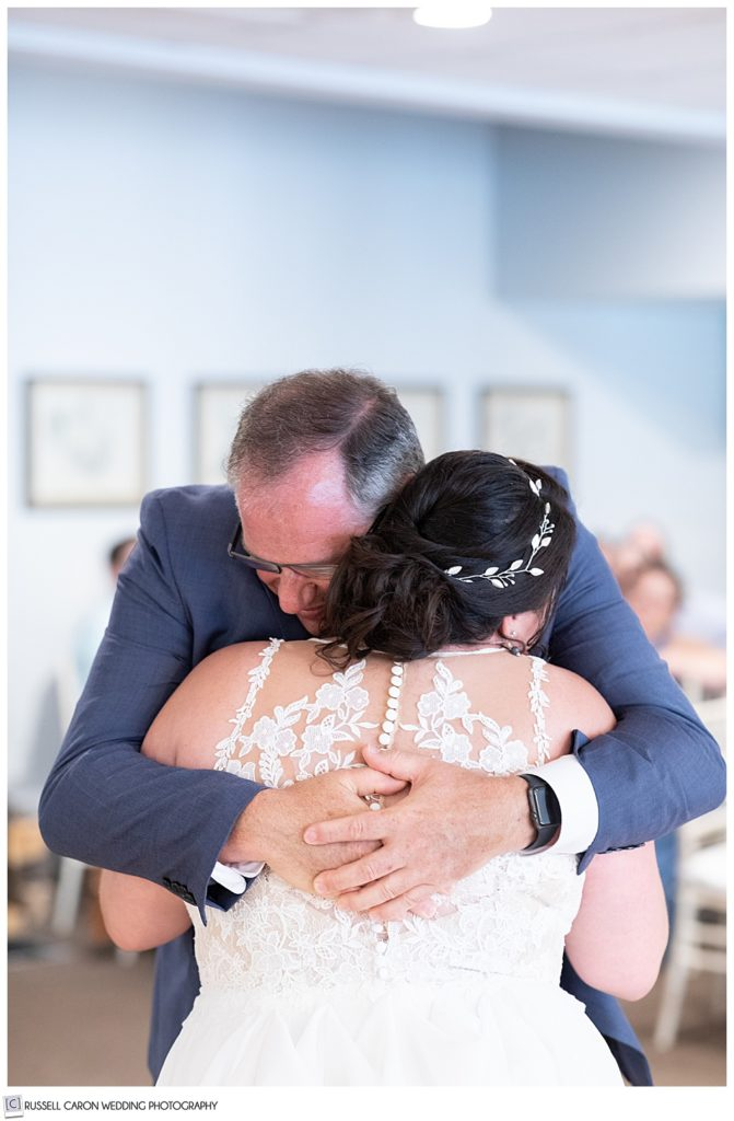 bride's dad hugging her after their father daughter dance