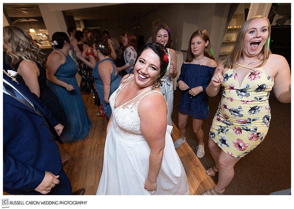 bride dancing with her friends  during her Edgecomb Maine wedding reception