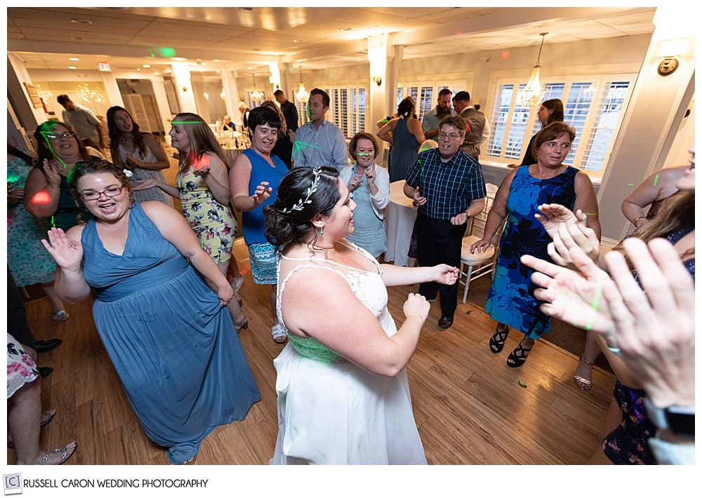 bride dancing with her friends at Sheepscot Harbour village Resort wedding