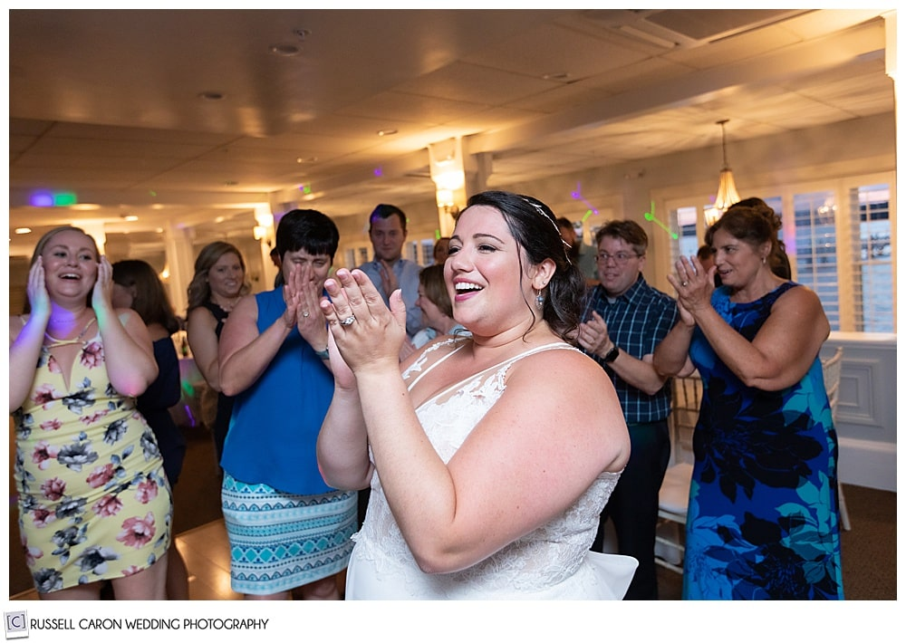 bride clapping her hands during her Sheepscot Harbour Village Resort wedding reception