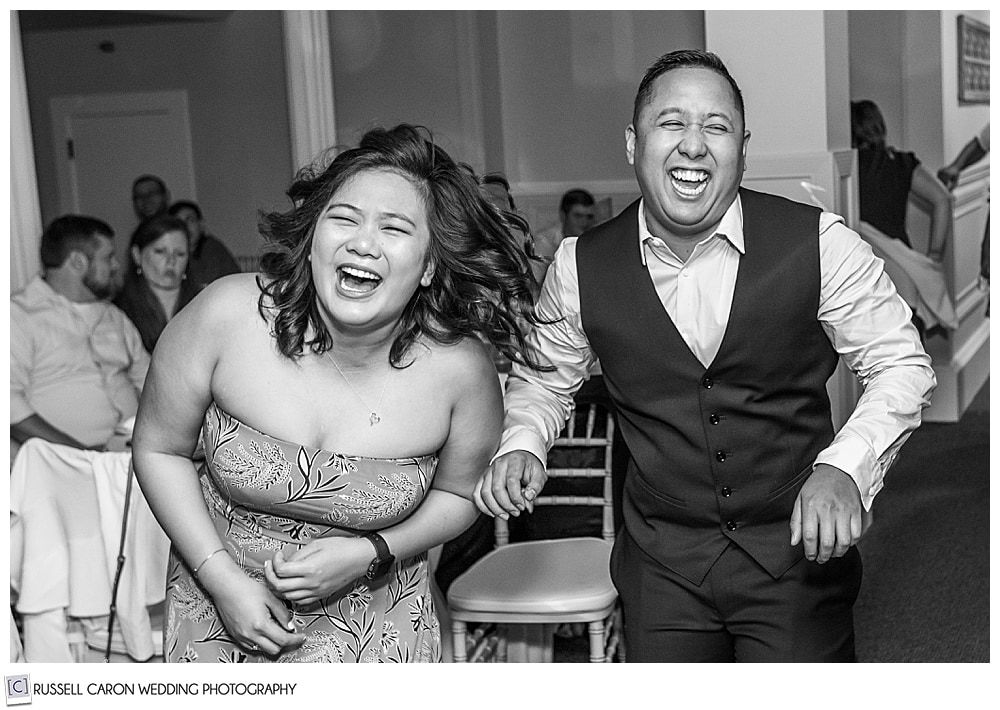 black and white photo of guests laughing