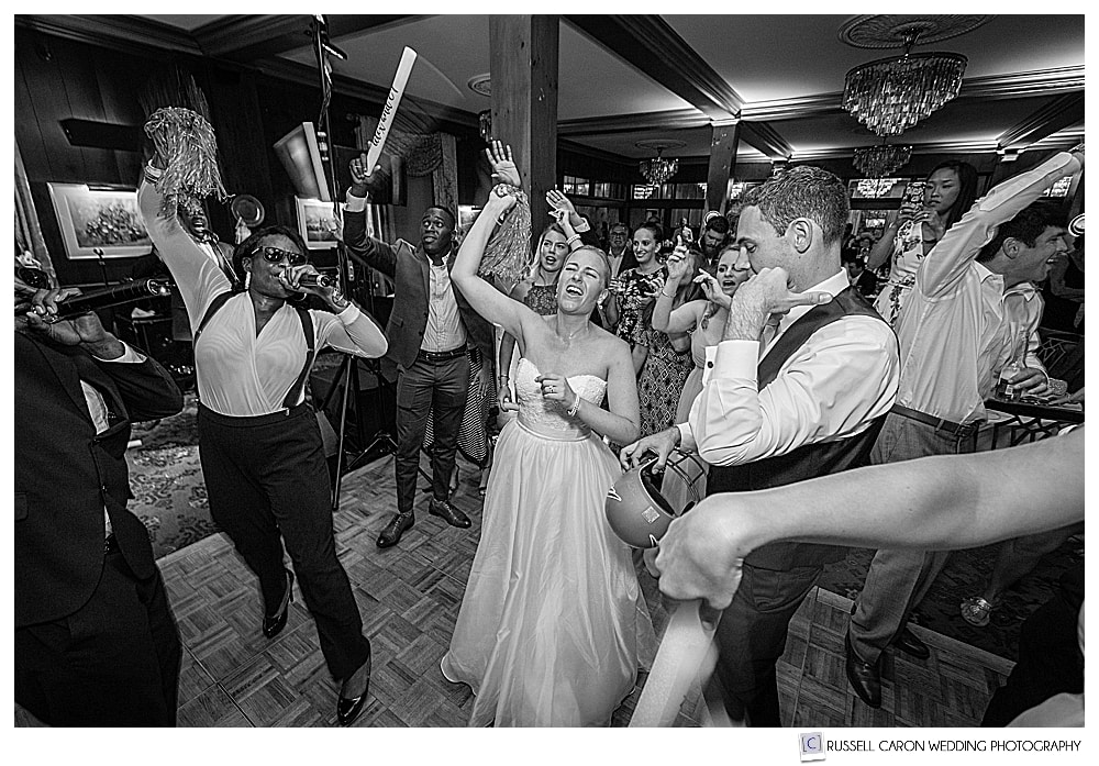 black and white photo of a Fun Colony Hotel wedding reception with bride and groom dancing to the World Premier Band