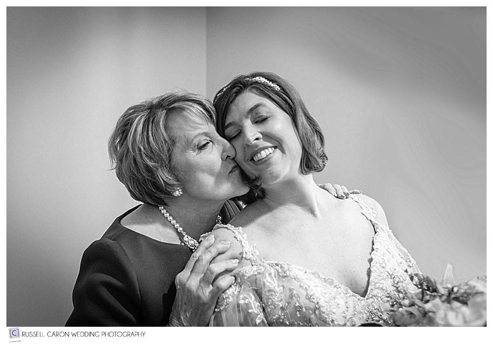 bride's mother kissing bride