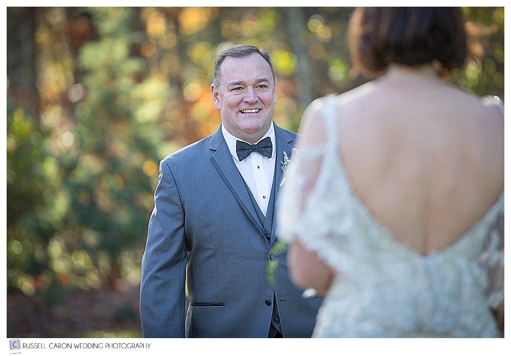 groom walking toward bride during first look