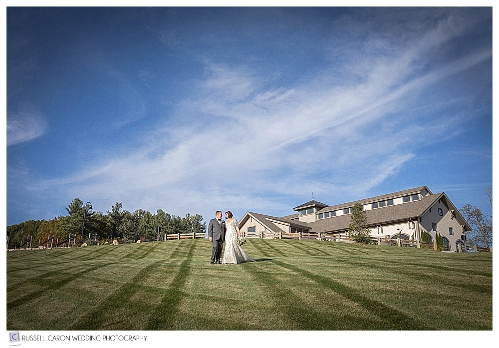 bride and groom on the lawn of the LaBelle Winery, Amherst, New Hampshire