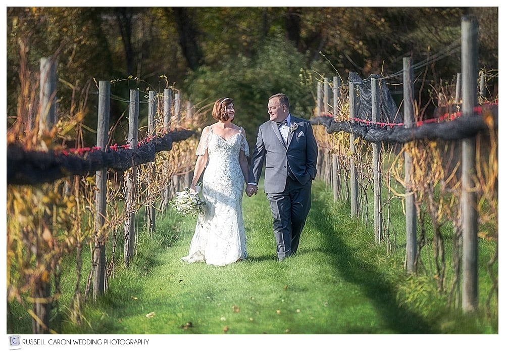 bride and groom walking in the vineyards during LaBelle Winery Wedding