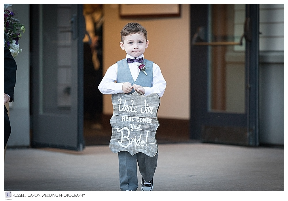 Ring bearer with sign, at LaBelle Winery, Amherst, New Hampshire