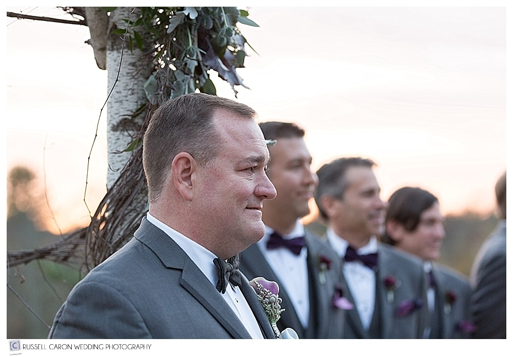 groom watches the wedding processional