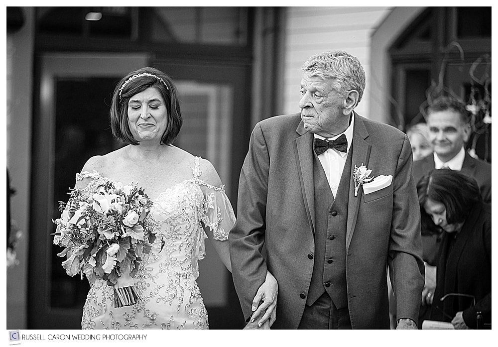 black and white photo of bride and her father walking down the aisle at LaBelle Winery