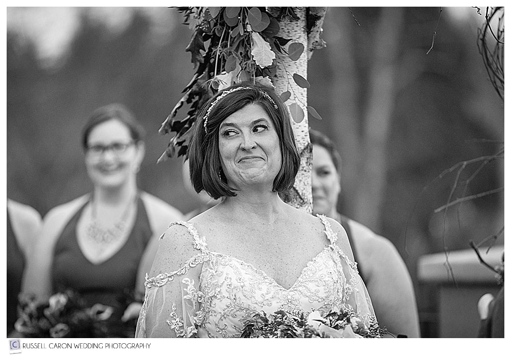 black and white photo of the bride during wedding ceremony