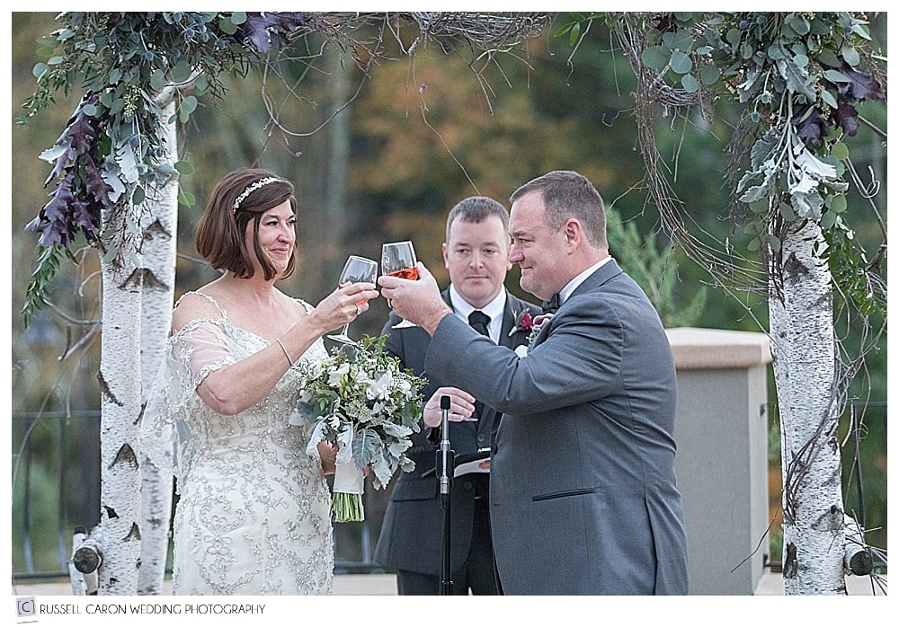 bride and groom share a toast with a glass of rose at their LaBelle Winery wedding