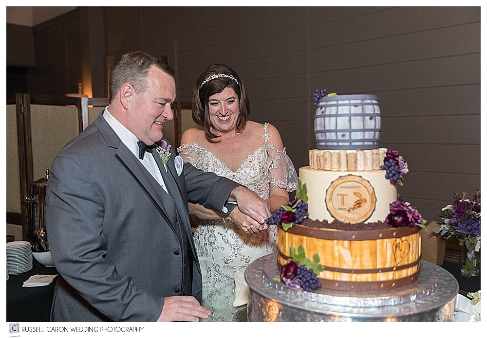 bride and groom cut cake by Jacques Pastry Shop