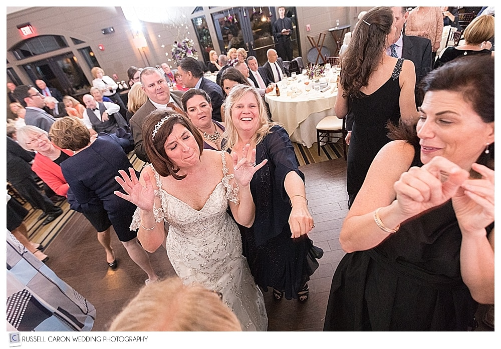 bride dancing with her friends