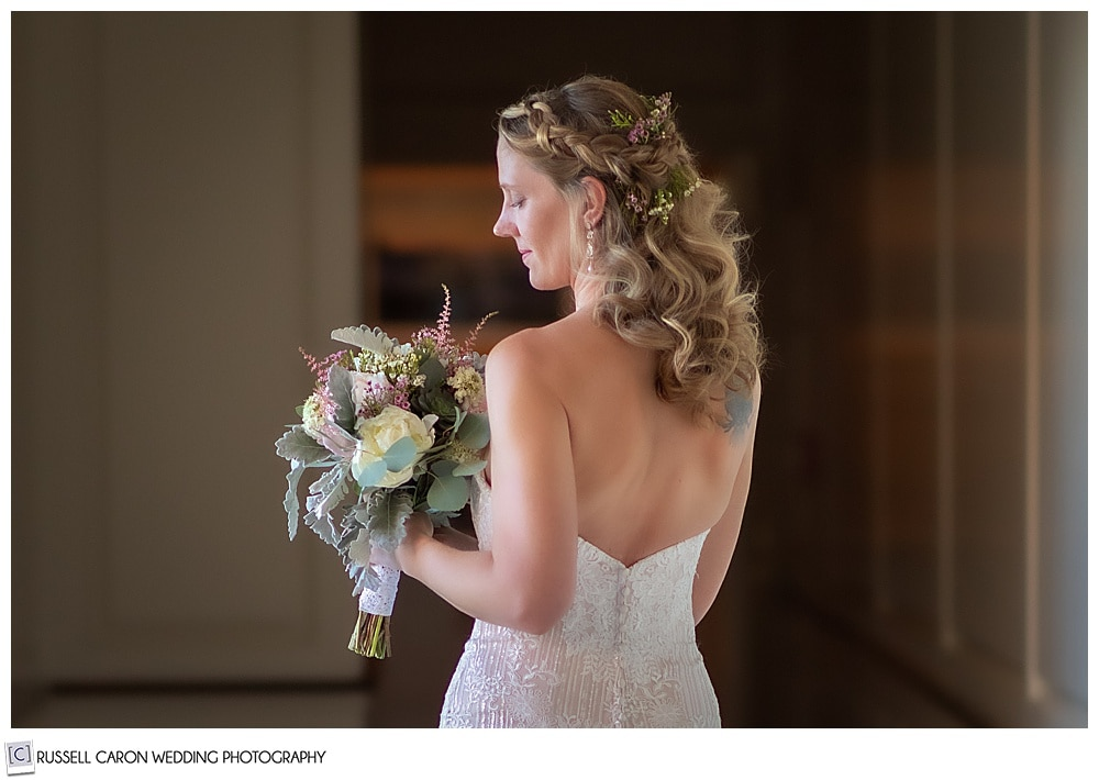 portrait of a bride with her back to the camera, facing her left