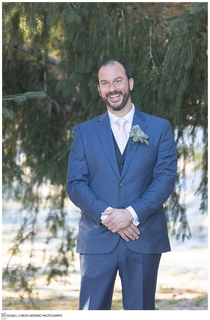 groom during a wedding day first look