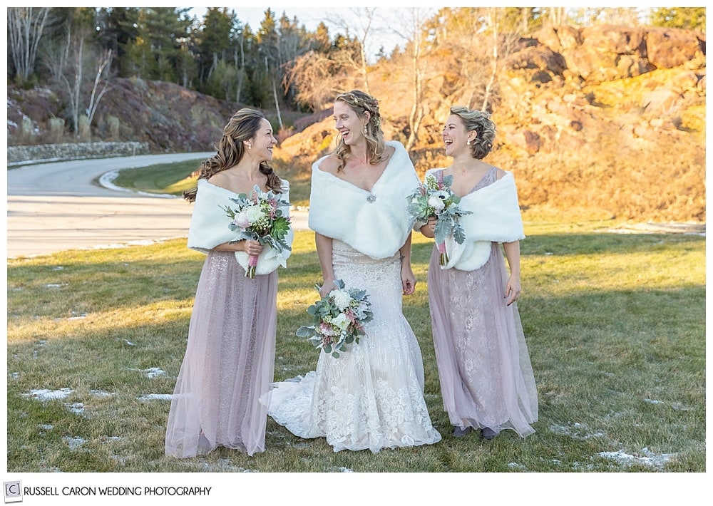 bride and two bridesmaids laughing