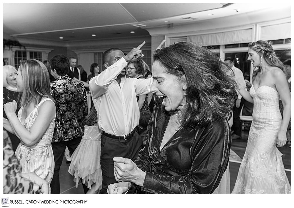 black and white photo of guests dancing at a midcoast maine wedding reception