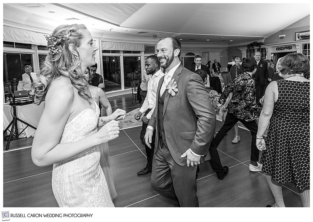 black and white photo of bride and groom dancing at their midcoast maine wedding reception