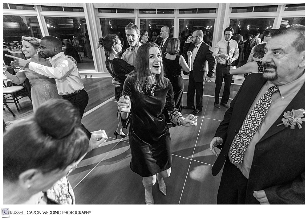 black and white photo of dancing at a midcoast maine wedding reception