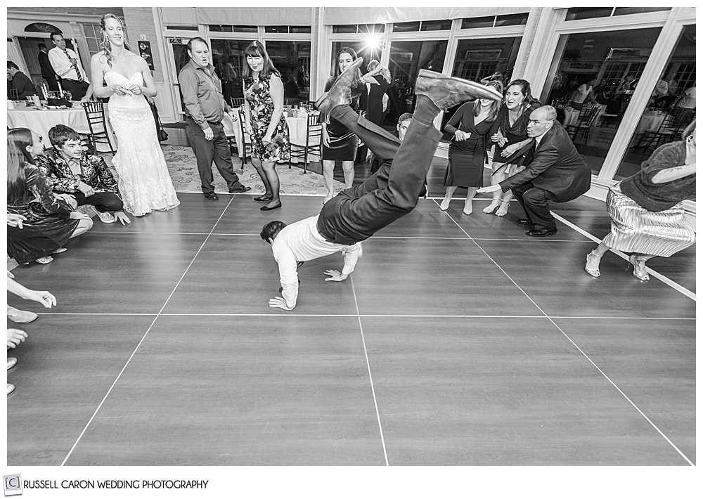 wedding guest dancing the worm at a midcoast maine wedding reception