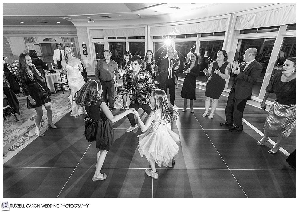 children on the dance floor at a midcoast maine wedding reception
