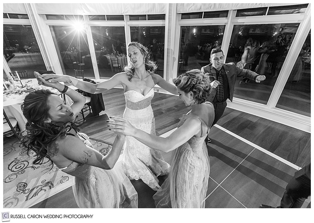 bride and bridesmaids dancing at point lookout midcoast maine wedding