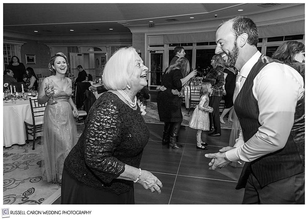 black and white photo of groom and his mother dancing