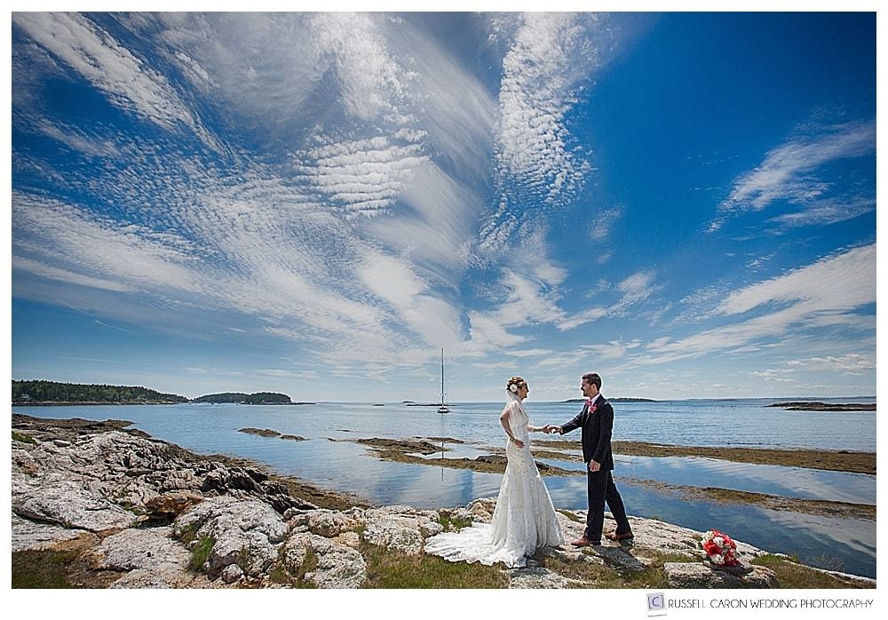Bride and groom on the rocks at Sebasco Harbor Resort, Phippsburg, Maine