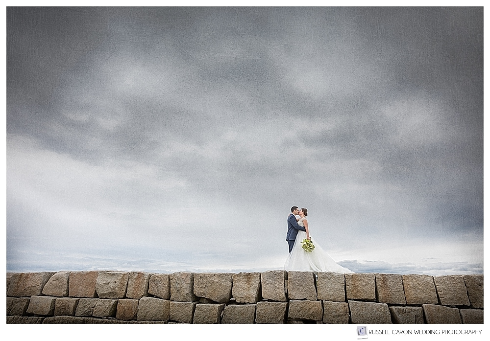 Bride and groom on the Kennebunkport Breakwater, Kennebunkport, Maine. One of our favorite top Maine wedding regions!