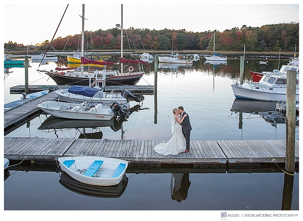 Bride and groom on the dock at the Nonantum Resort, Kennebunkport Maine