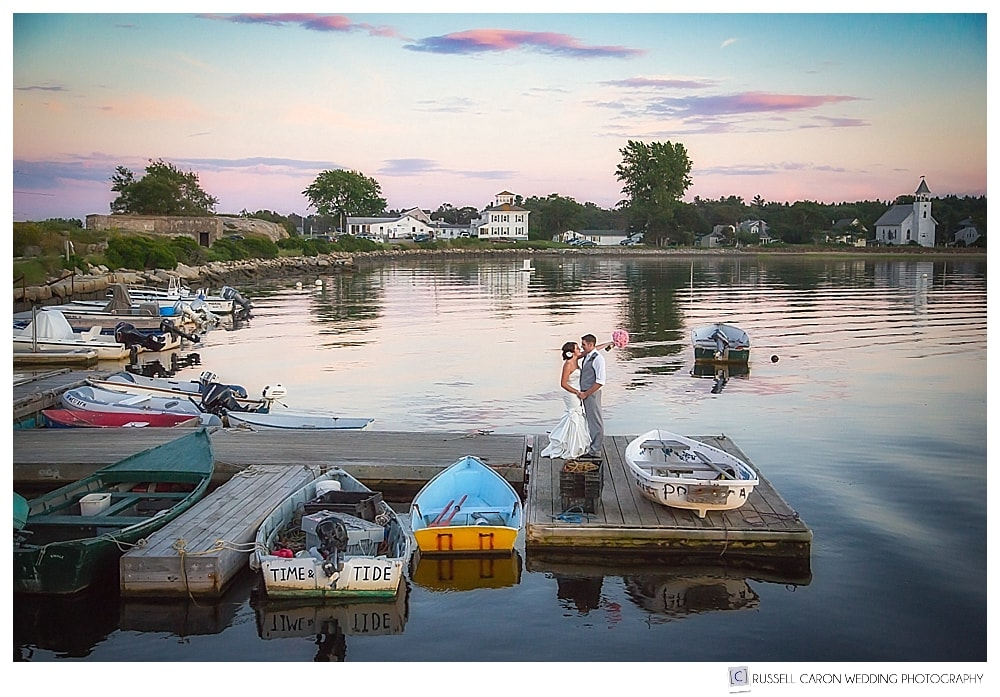Bride and groom on the dock at Fort Popham, Maine
