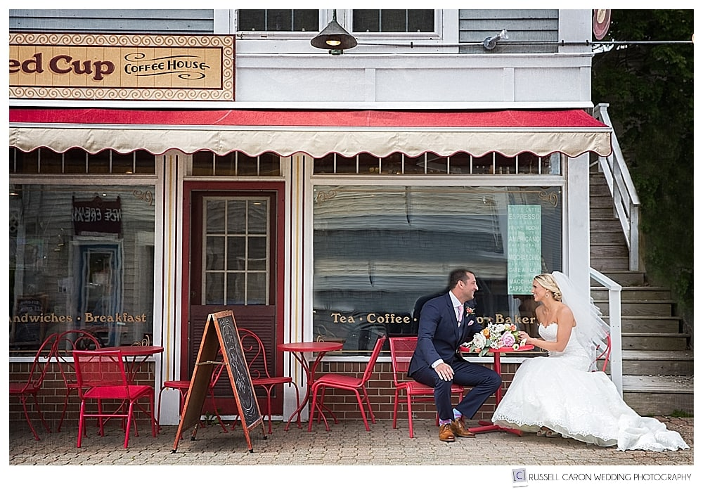 Bride and groom at a coffee shop in Boothbay Harbor Maine