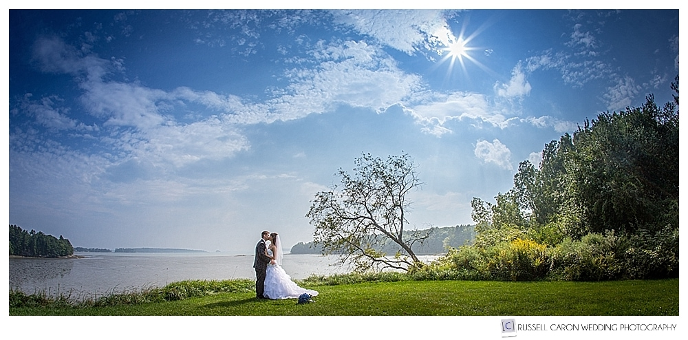 Bride and groom on the lawn at the Wolfe's Neck Center, Freeport, Maine