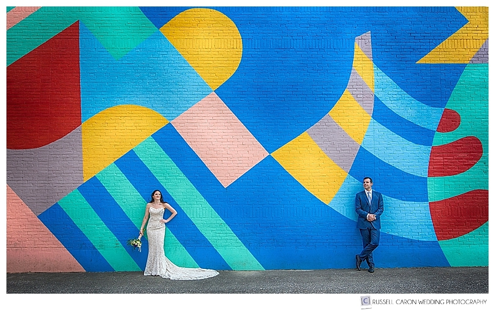 Bride and groom in front of wall mural on the wall of Rock City Coffee, Rockland Maine