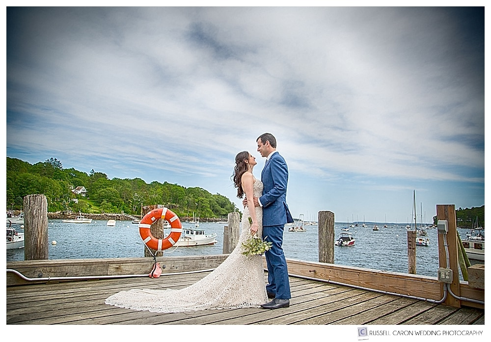 Bride and groom on the dock at Rockport Harbor maine