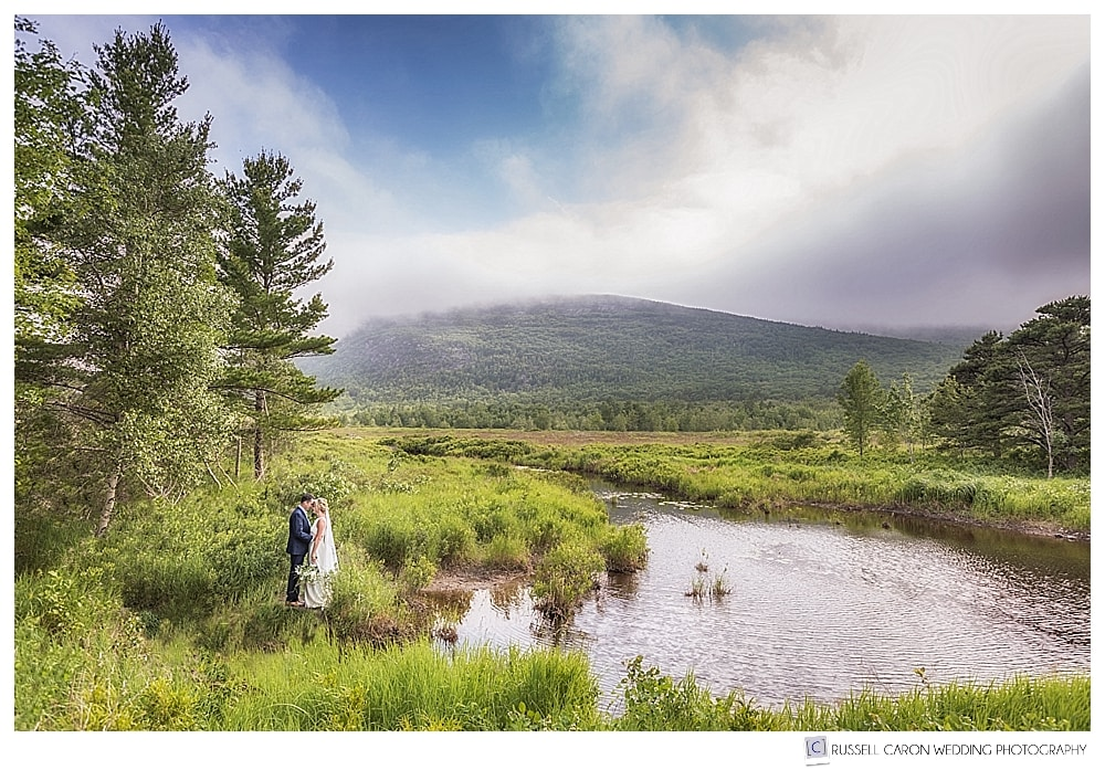 Bride and groom near a stream in Acadia National Park, Bar Harbor Maine