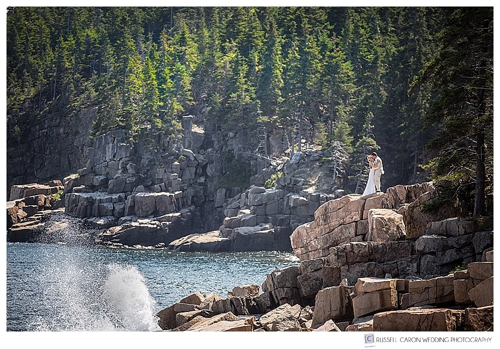 Bride and groom on the pink granite in Acadia National Park, Bar Harbor Maine