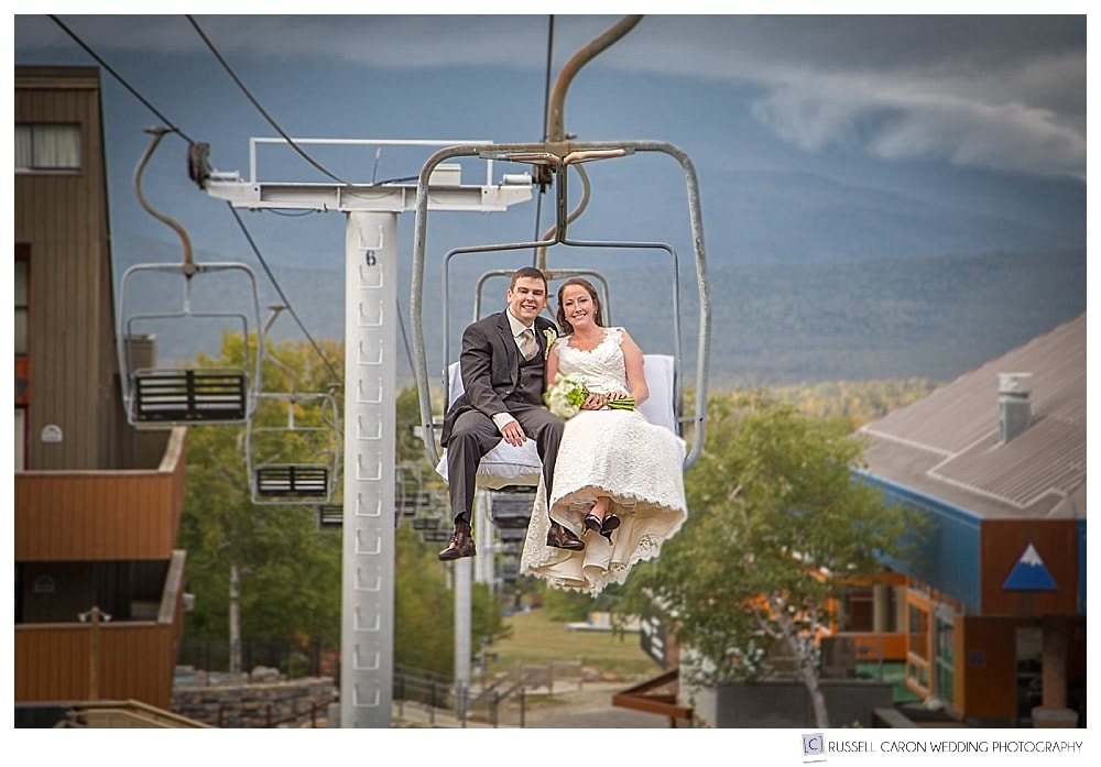 Bride and groom on the chairlift at Sugarloaf Mountain, Maine