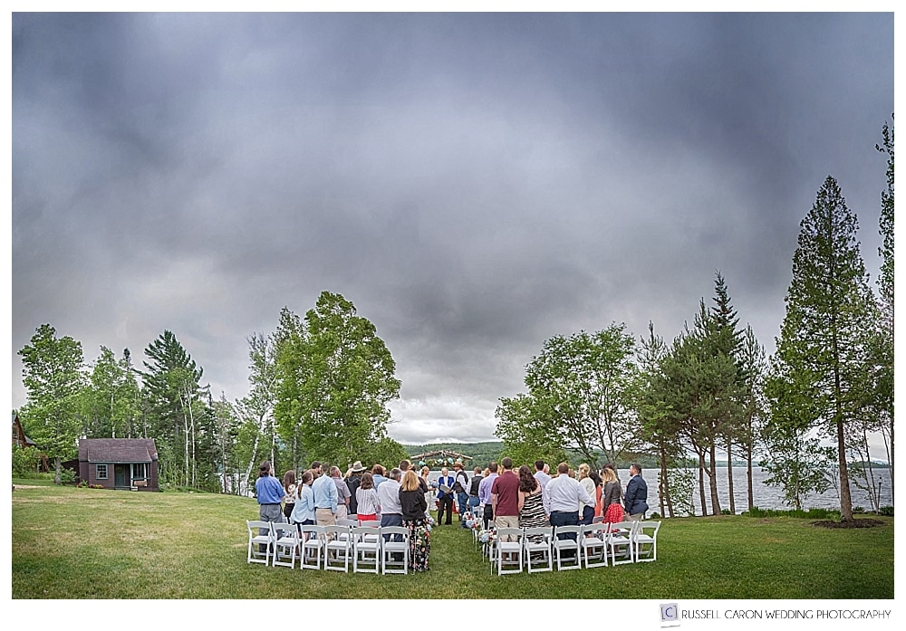 Wedding ceremony on the lawn at Loon Lodge, Rangeley lake, Maine