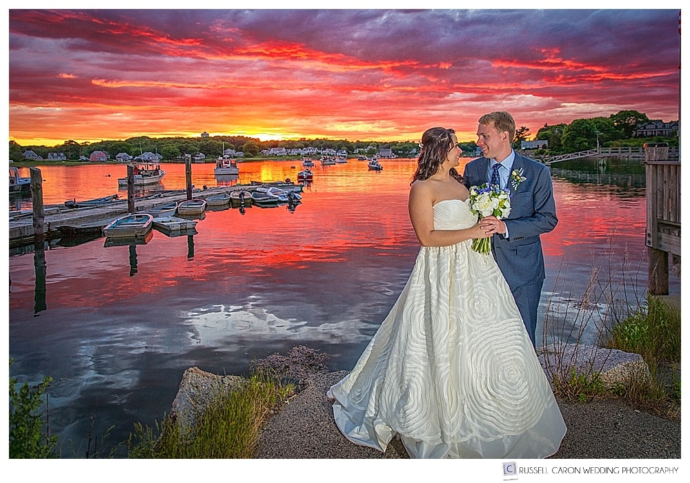 Bride and groom with spectacular sunset in Cape Porpoise Maine