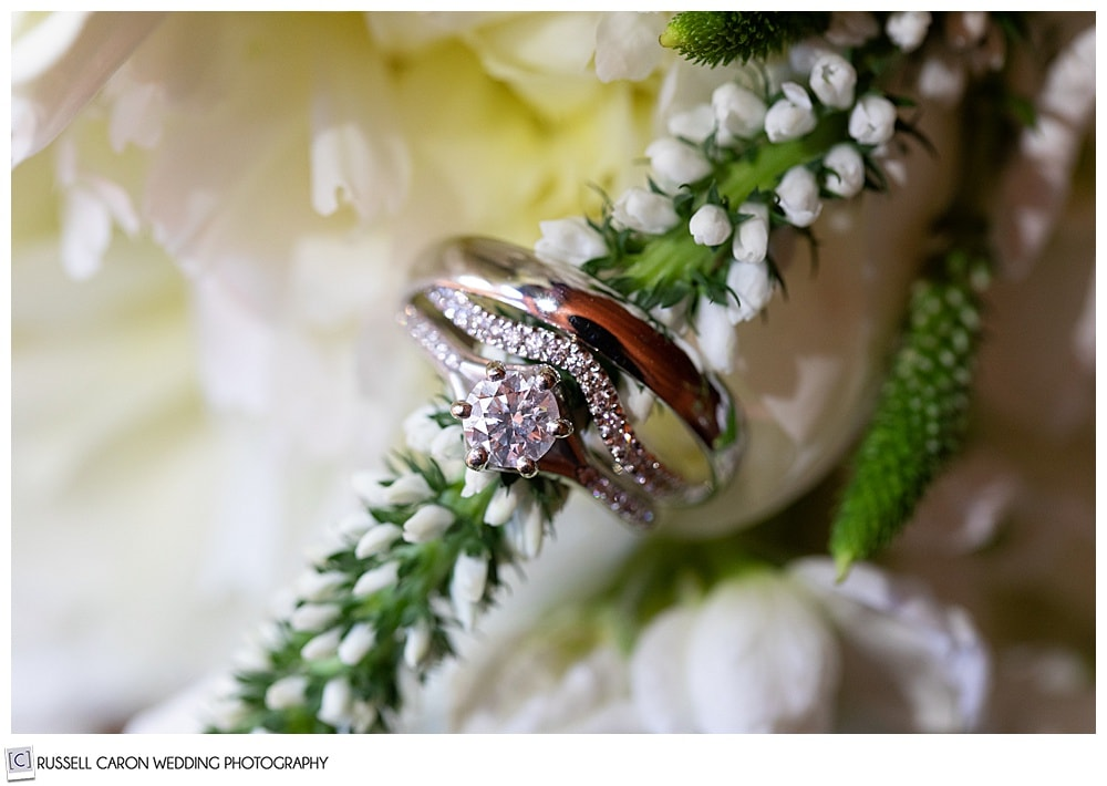 wedding ring detail photo with flowers