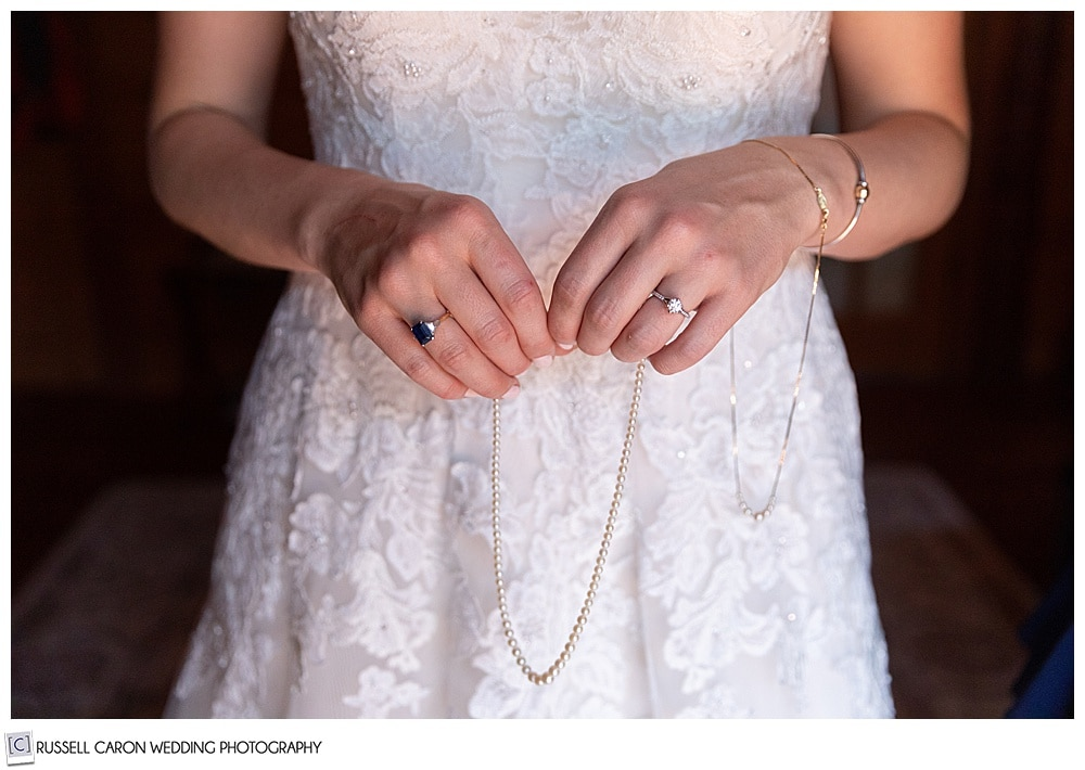 bride holding a string of pearls