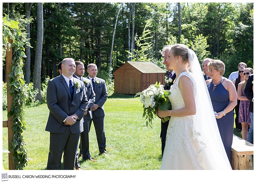 bride and her father reach the groom at a Moose Lake Ranch wedding