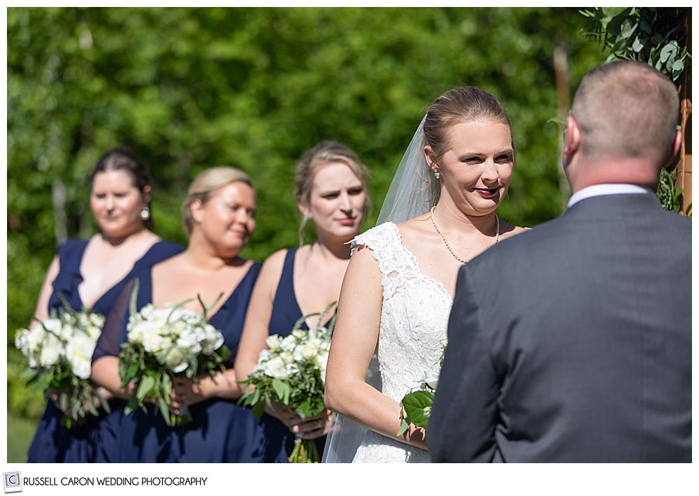 bride and bridesmaids during an outdoor Moose Lake Ranch wedding ceremony