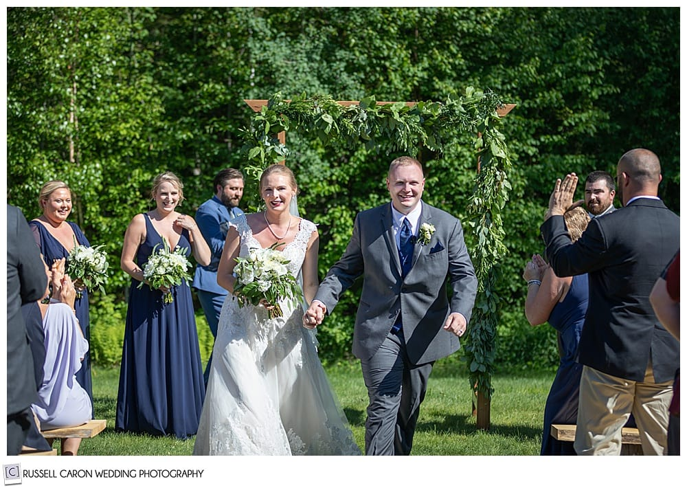 bride and groom during their recessional at Moose Lake Ranch