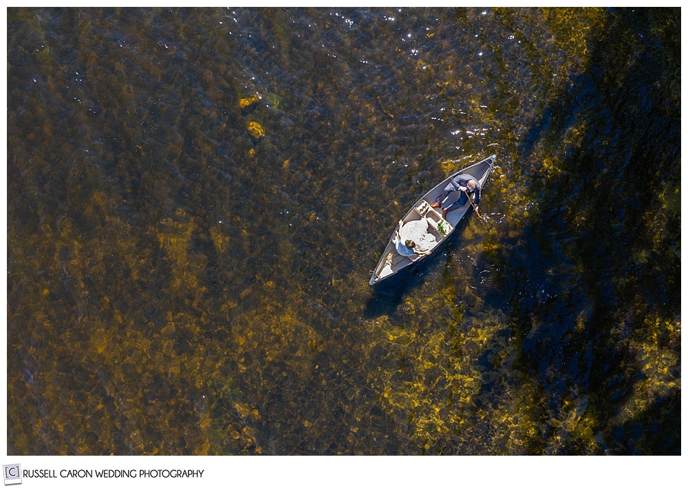 wedding drone photo of a bride and groom in a canoe on a lake