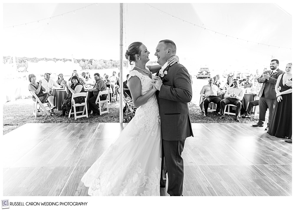 black and white photo of a bride and groom slow dancing