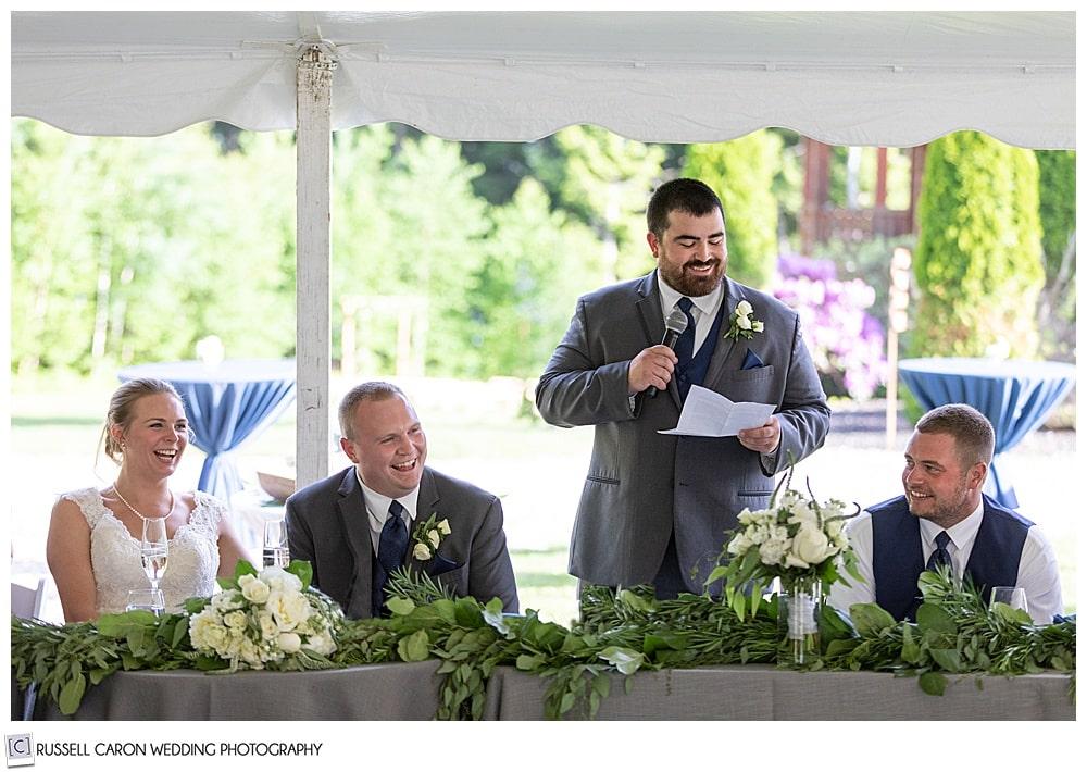 groomsman giving a toast